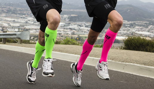 Couple running in CEP Night Run Socks